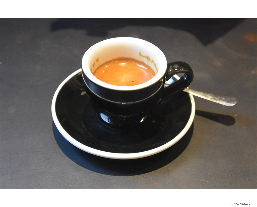 ... while my shot of the house-blend espresso was served in a classic black cup.