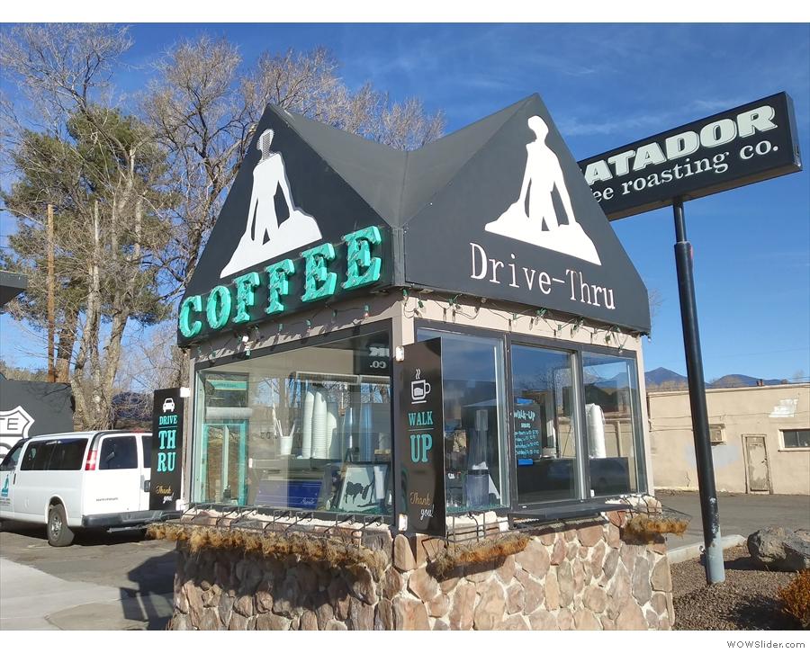 The kiosk serves as both a walk-up coffee kiosk and a drive-through.