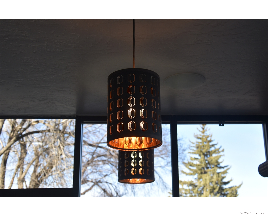 Meanwhile, in the coffee shop part, the light-bulbs hide in these cylindrical shades.