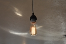 ... while the roastery, which has plenty of windows, also has exposed light bulbs.