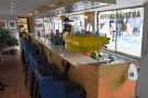 The counter/bar is on the right, next to the quayside. You can sit here on the bar chairs.