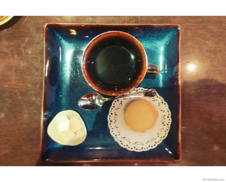 My coffee, from above, beautifully presented on a ceramic tray.