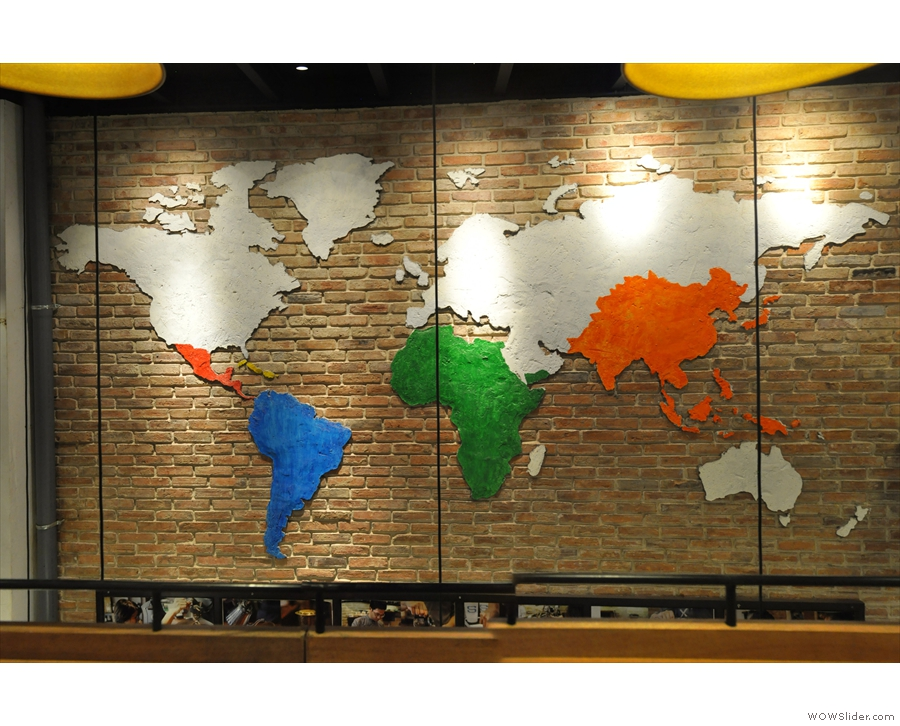Meanwhile, spanning upstairs and down, this world map is on the wall behind the counter.