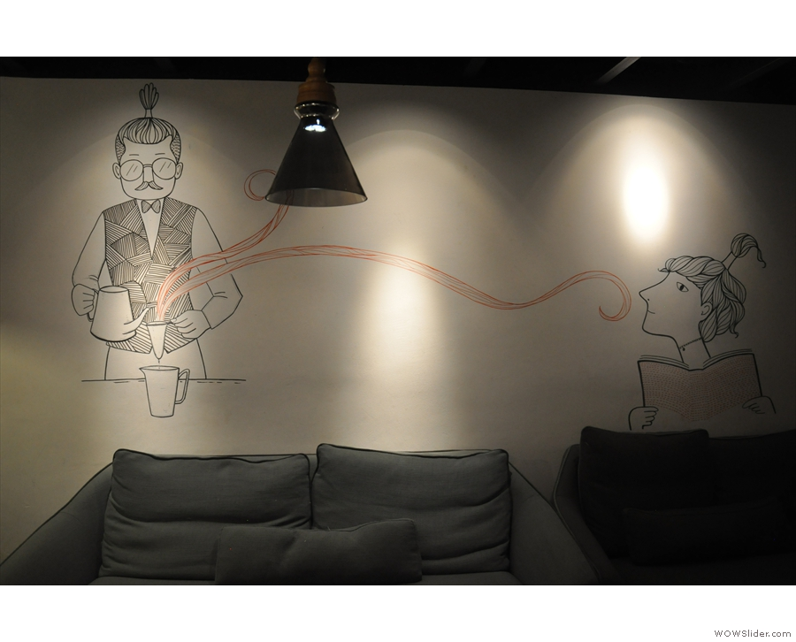 This gorgeous drawing is on the opposite wall...