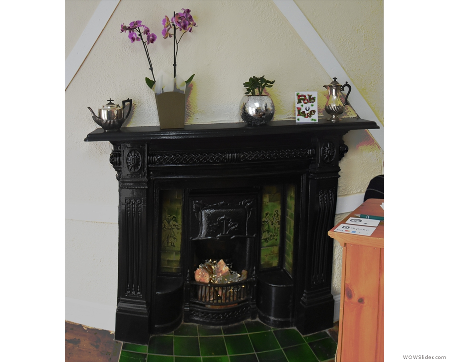 There are some lovely features, including this magnificent fireplace in the front room.