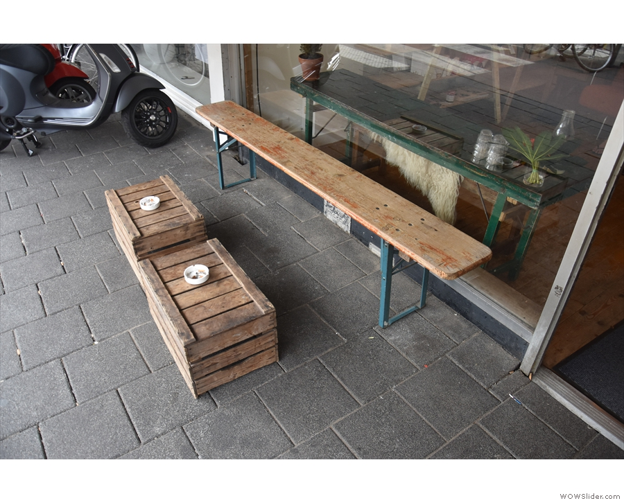 There's not much to the shop front, just this bench outside, with a small one to the right.