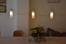 This means that there are lots of light-fittings. These hang above the multi-level table...