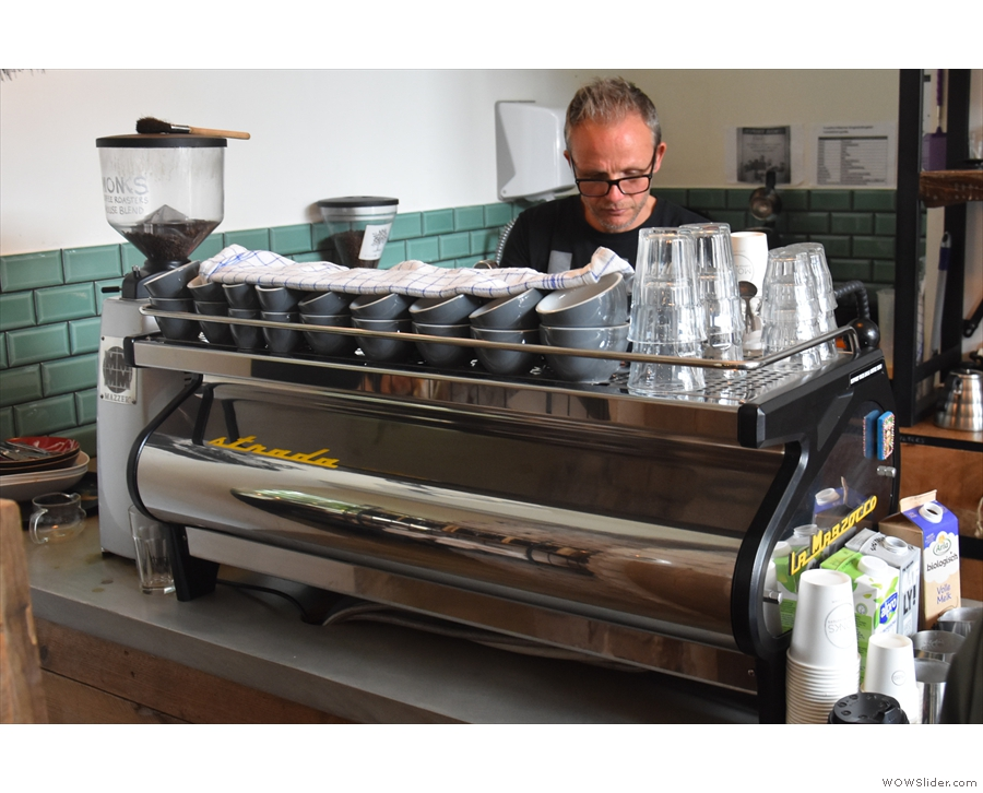 At the other end of the counter, past the till, is the espresso machine...