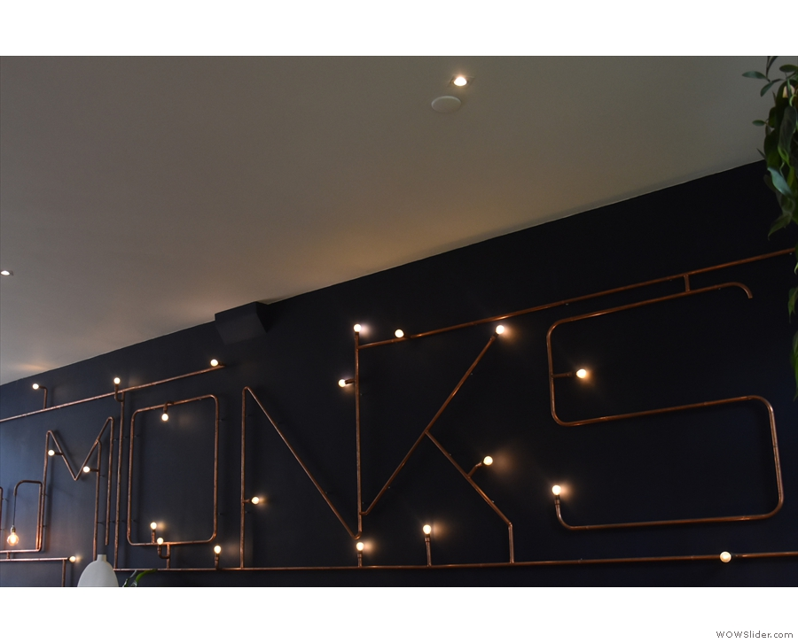 ... which spell out 'Monks' in light bulbs and copper piping!