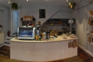 ... with cakes to the right, till in the middle & espresso machine + batch-brew on the left.