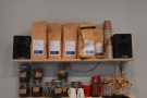 .. with bags of the current coffee on the shelves above.