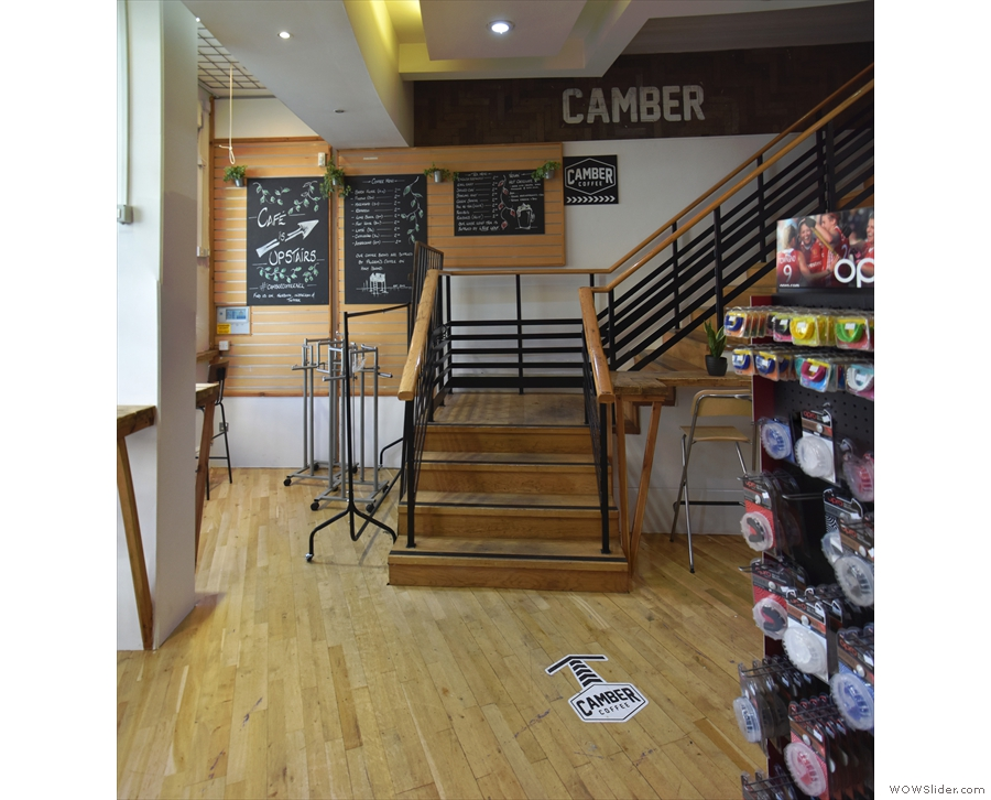 Alternatively, and probably more sensibly, if you go in via the fitness shop part on the right, you'll find these stairs, which are by the big 'Camber Coffee' window we saw earlier.