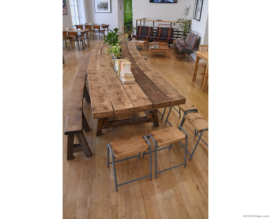 The communal table, seen from the other end. There's a bench, plus lots of stools.