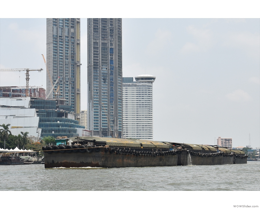 It's not just small ferries that use the river. There are huge barges too...