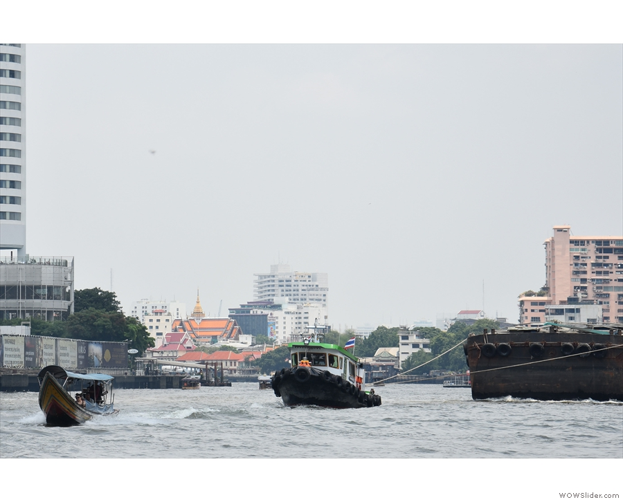 ... in this case, three barges, being pulled by a tug.