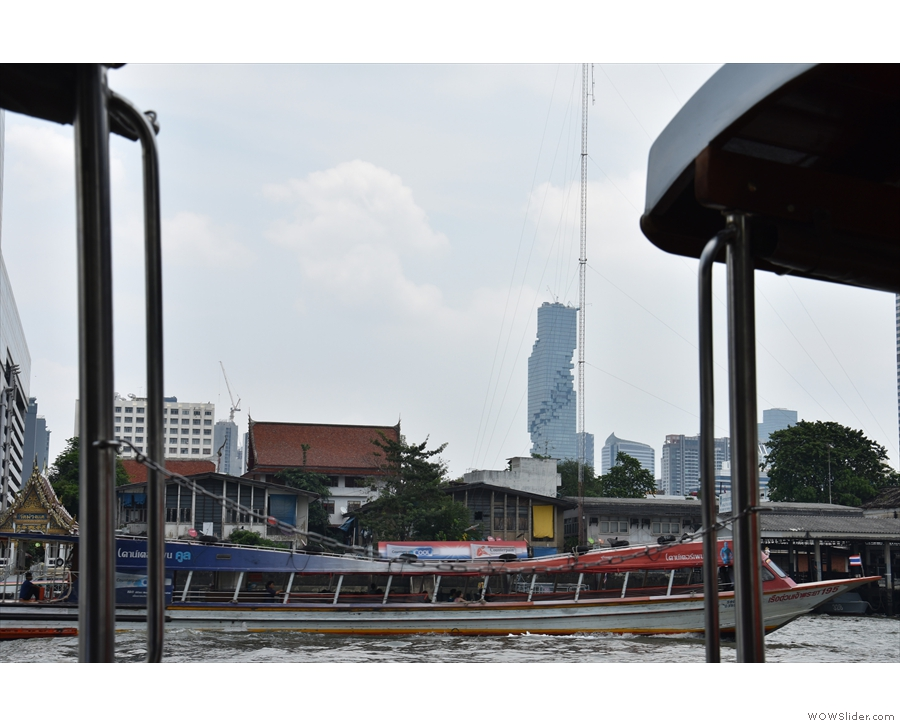 I think this is one of the ferries. Or maybe a tour boat. Neat tower, by the way.