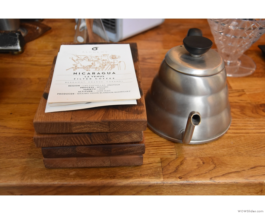 The wooden trays are used for serving, with the info cards handed out with the coffee.