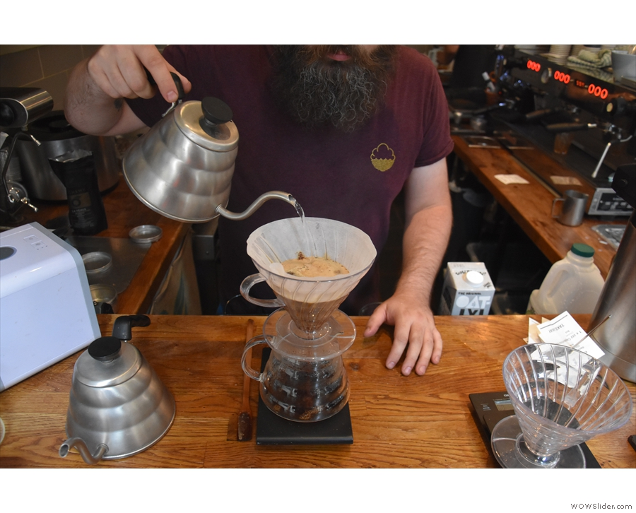 In a technique I've not seen before, there is a single main pour, the barista pouring the...