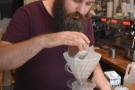 The ground coffee is added to a pre-rinsed filter paper.