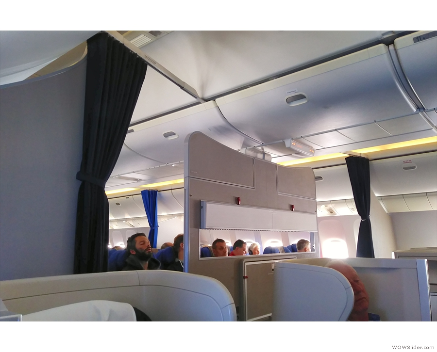 In preparation for landing, the curtains are drawn back between the different cabins.