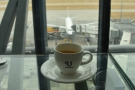 My coffee, overlooking a British Airways flight at the gate.