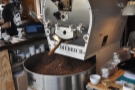 The roaster in action back in 2017. All the coffee for the four branches is roasted here.