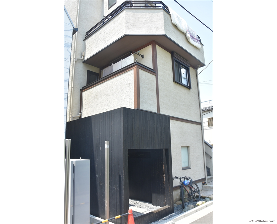 This interesting house on a back street in Omotesando is the unlikely home of one...