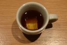 ... served in an espresso cup with an ice cube dropped in for good measure.