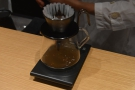 The first pour is to let the coffee bloom.