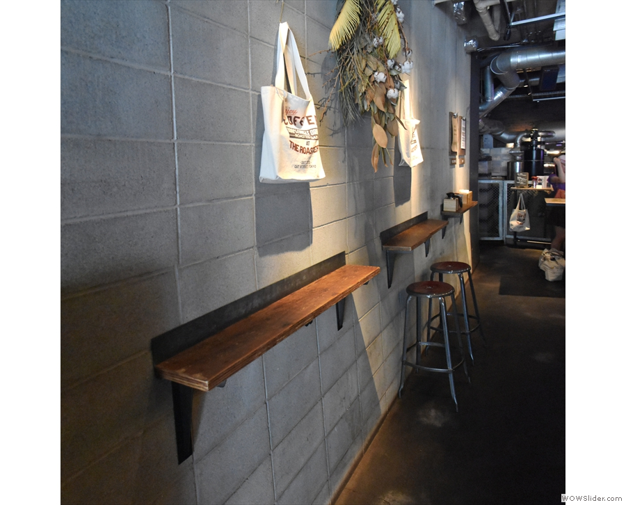 Well, more standing, at these narrow bars, than seating, but there are a few stools.