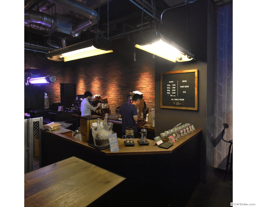 On the right is the pour-over bar, behind which is the packing area for the roastery.