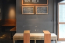 Off to the right is this simple bench-seat, with two stand-alone tables under the menu.