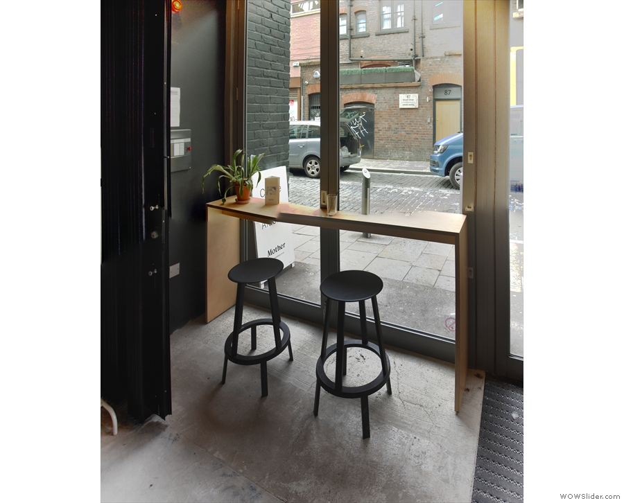 It's not all tables though. There's a two-person window-bar to the right of the door...