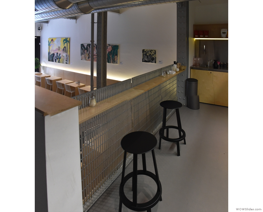 ... downstairs, a pair of bar stools up on the balcony look out over Mother Espresso.