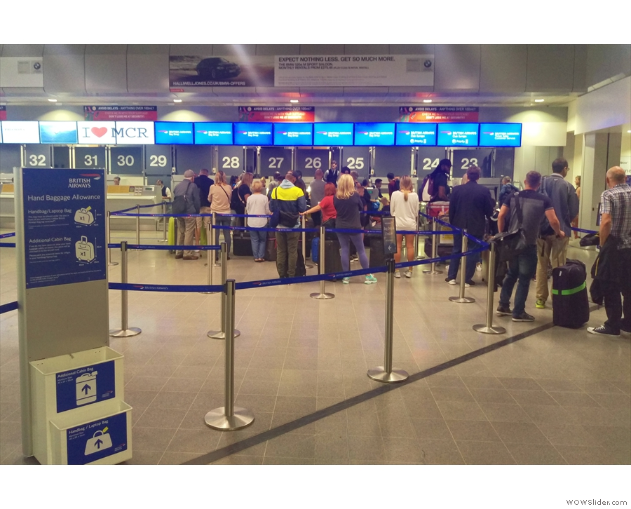 Manchester Airport, T3, and an unusual sight: queues at check-in. This was due to a...
