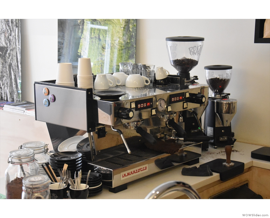 The La Marzocco Linea espresso machine is at the front of the counter...