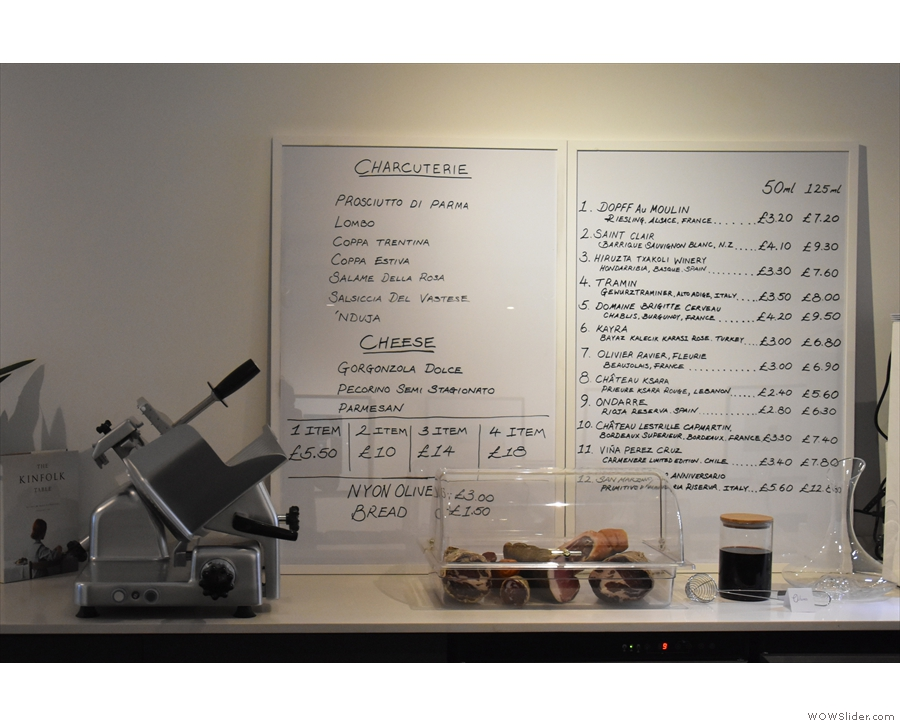 The final counter dispenses wine (right) and charcuterie (left).