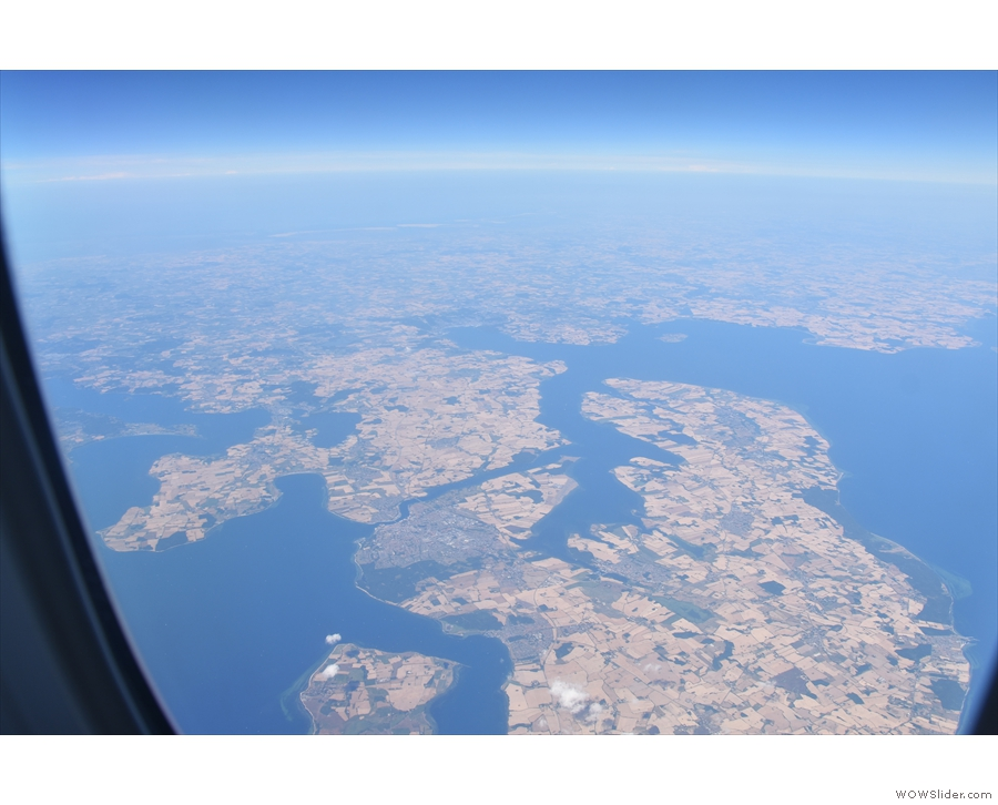 We fly across the southern tip of Denmark by the German border...