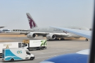 A Qatar Airlines A380 goes by.