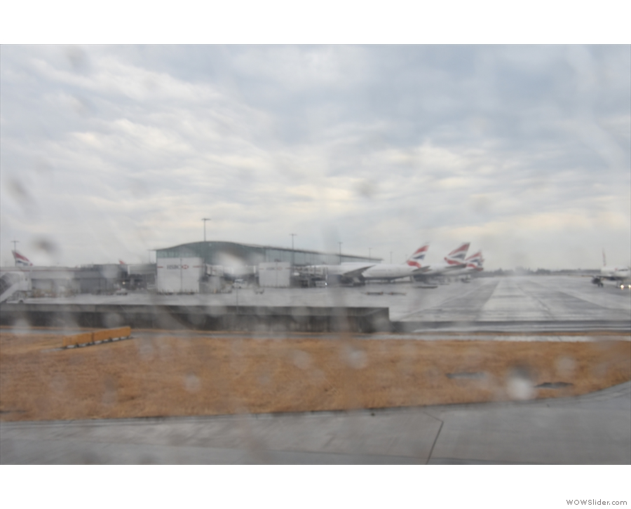 Although it had stopped raining, it was still pretty wet as we taxied past Terminal 5.