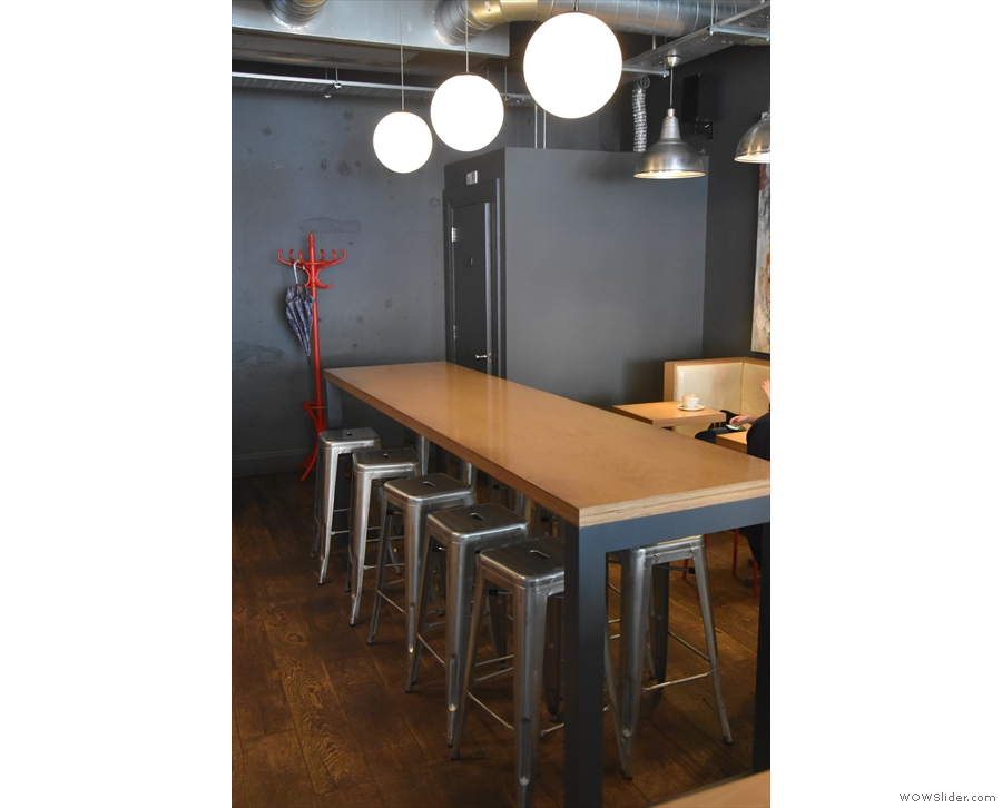That's not all. There's more seating at the back, starting with this central, communal table.