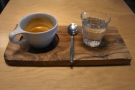 ... the Ethiopian single-origin, served on a wooden tray with a glass of water.