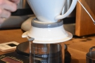 The Bonavita Dripper is placed on top of a glass jar...