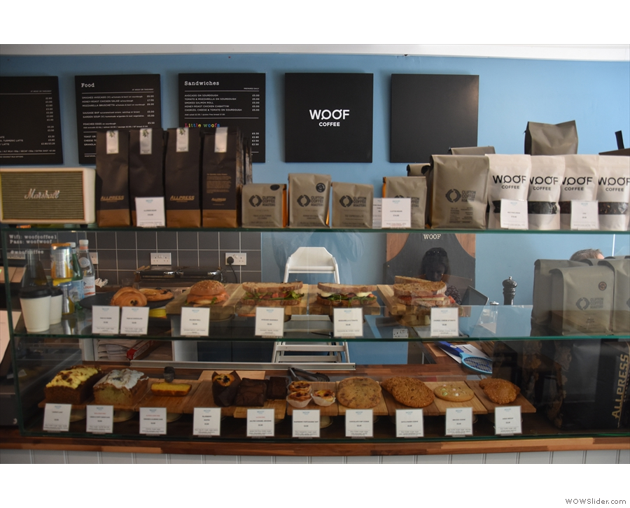 The counter has the food, cakes & sandwiches, in a large glass display case at the front.