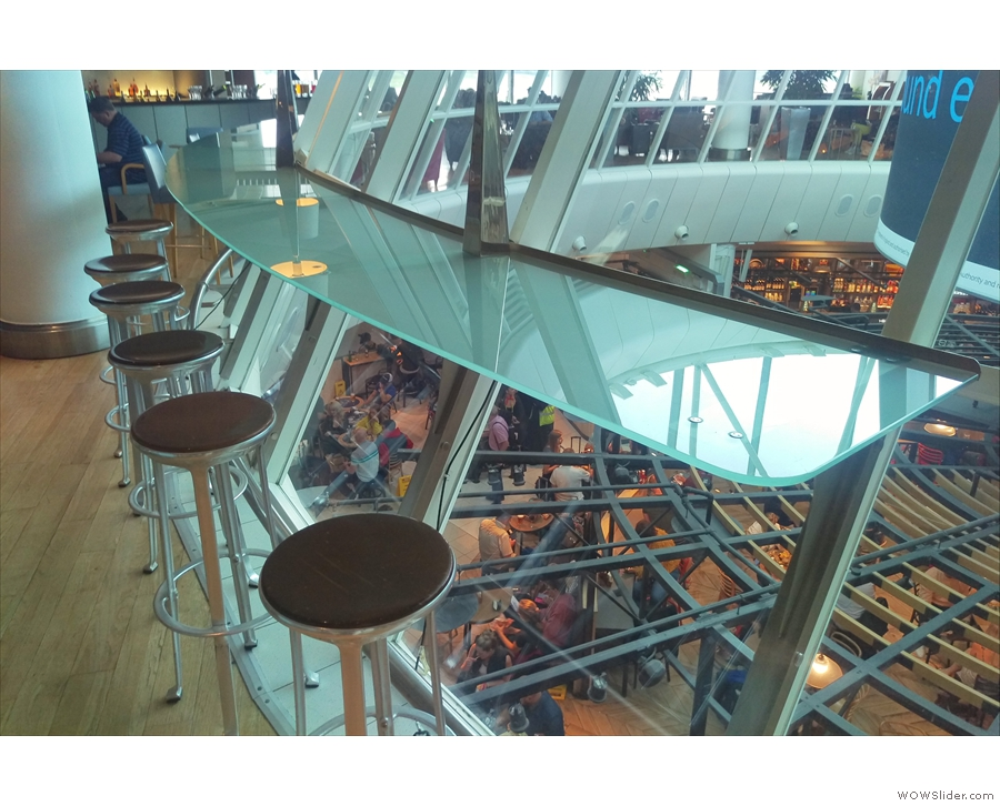 Back in the main lounge, there's more seating at this glass bar overlooking the terminal.