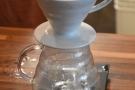 Next, set the V60 and carafe on the scales...