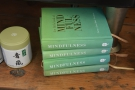 ...  and, as well as coffee, he sells these Little Books of Mindfulness...