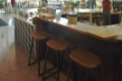 ... with another look at the three stools along the corner at the right-hand end.
