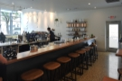 Finally, a row of eight stools lines the rear side of the counter...