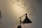 ... including these angle-poise lamps, one above each table on the back wall.